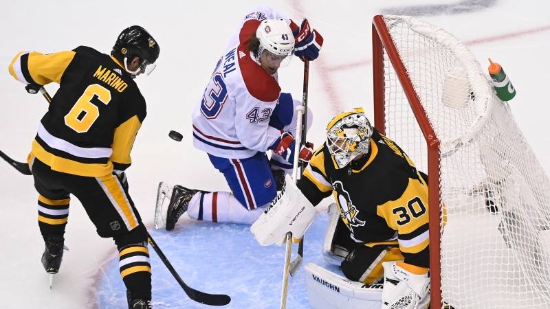 Montreal Canadiens centre Jordan Weal (43) misses a pass as Pittsburgh Penguins goaltender Matt Murray (30) and Penguins defenceman John Marino (6) look on during third period NHL Eastern Conference Stanley Cup playoff action in Toronto, Monday, Aug. 3, 2020. THE CANADIAN PRESS/Nathan Denette