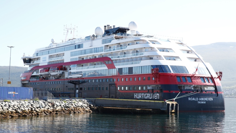 Norwegian cruise ship MS Roald Amundsen moored in Tromso, Norway, Monday Aug. 3, 2020. After 40 people, including four passengers and 26 crew members on the Norwegian cruise ship have been tested positive for the coronavirus, the operator says it was stopping for all cruises with its three vessels. The 40 people were admitted to the University Hospital of North Norway in Tromsoe, north of the Arctic Circle,  where the empty ship has docked. (Terje Pedersen/NTB Scanpix via AP)