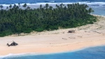 In this photo provided by the Australian Defence Force, an Australian Army helicopter lands on Pikelot Island in the Federated States of Micronesia, where three men were found, Sunday, Aug. 2, 2020, safe and healthy after missing for three days. (Australian Defence Force via AP)