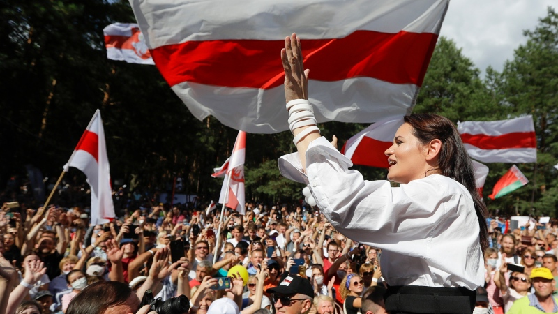 In this file photo taken on Sunday, Aug. 2, 2020, Sviatlana Tsikhanouskaya, candidate for the presidential elections greets people waving old Belarus flags during a meeting to show her support , in Brest, 326 km (203,7 miles) southwest of Minsk, Belarus.  Tsikhanouskaya, 37-year old former English teacher without any political experience seems an unlikely challenger to the authoritarian leader of Belarus, whose rule has spanned more than quarter-century. (AP Photo/Sergei Grits, FILE)