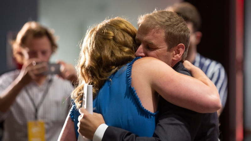 Dr. Andrew Furey is congratulated by his wife, Dr. Allison Furey as he is announced as leader of the provincial Liberal Party at the St. John's Convention Centre in St. John's, N.L. on Monday, August 3, 2020. (THE CANADIAN PRESS/Paul Daly)