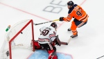 Edmonton Oilers' Connor McDavid (97) scores against Chicago Blackhawks goaltender Corey Crawford (50) during first period NHL Stanley Cup qualifying round action in Edmonton, Monday, Aug. 3, 2020. THE CANADIAN PRESS/Codie McLachlan