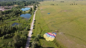 A pair of hot-air balloons lie in a field just south of Teton Village in Wyoming after a crash Monday, Aug. 3 .Twelve people were hospitalized after the crash. (Bradly J. Boner/Jackson Hole News & Guide/AP/CNN)