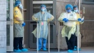 Security guards and a heath-care worker wait for patients at the Women's College Hospital Covid-19 testing centre on Saturday June 6, 2020. (Frank Gunn/The Canadian Press)