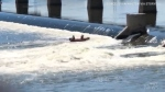 Tulsa firefighters rescued a person caught in rushing water and holding on to the pillar of a dam on the Arkansas River over the weekend.