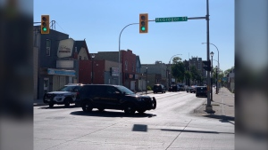 Selkirk Avenue is closed between McGregor and Salter Streets after Winnipeg police respond to a serious incident Tuesday morning. (CTV News Photo/Jamie Dowsett)