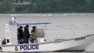 Ottawa Police officers on a boat on the Ottawa River near Bate Island during a search for the second of two men reported missing Friday night. The body of one man was recovered overnight. Aug. 1, 2020.