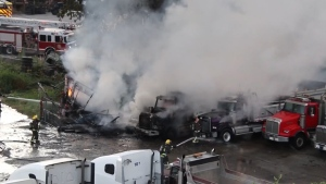 Surrey fire crews fight a blaze at a truck yard on Aug. 4, 2020.