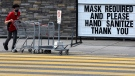 A staff member wears a mask as he collects carts at a store in Ottawa, on Saturday, Aug. 1, 2020, in the midst of the COVID-19 pandemic. (Justin Tang/THE CANADIAN PRESS)