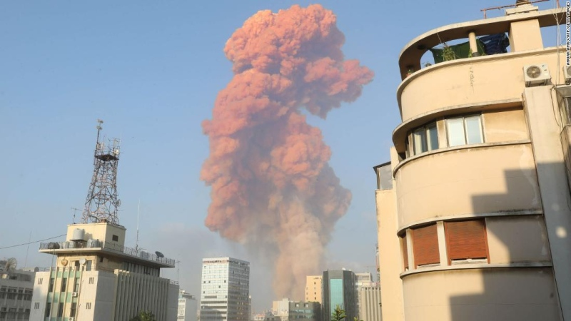 A red cloud hangs over Beirut in the wake of an explosion at the port on Tuesday. (AFP)