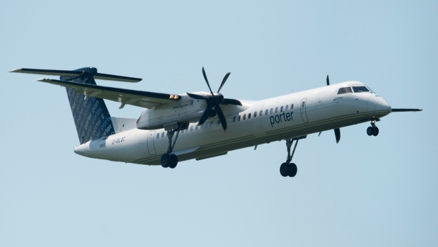 An Porter airlines flight makes its final approach as it lands at the airport Tuesday July 2, 2019 in Ottawa. Porter Airlines is extending its suspension of all of its flights by another month until July 29. THE CANADIAN PRESS/Adrian Wyld