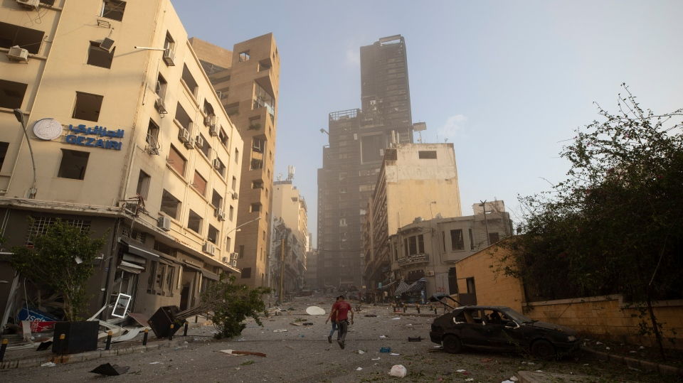 Aftermath of a massive explosion is seen in in Beirut, Lebanon, Tuesday, Aug. 4, 2020. (AP Photo/Hassan Ammar)