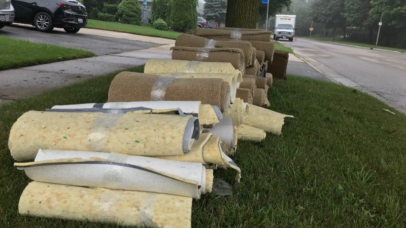 Soaked carpets line a boulevard along Millbank Drive in London, Ont. on Tuesday, Aug 4, 2020. (Sean Irvine / CTV News)