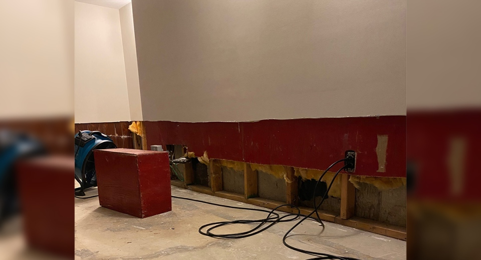 A flooded basement on Millbank Drive has drywall cut and flooring removed as a drying fan runs in the background in London, Ont. Clean up continues on Tuesday, Aug. 4, 2020 after heavy weekend rain. (Submitted photo)
