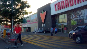 Ottawa police are looking to speak to the three people in this photo, who were in the Canadian Tire parking lot at Merivale Rd./Woodfield Dr. Friday, July 31, at around 8:20 p.m. (Ottawa police handout)