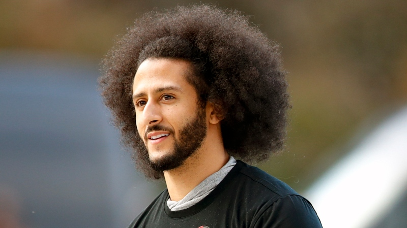 FILE - In this Nov. 16, 2019, file photo, free agent quarterback Colin Kaepernick arrives for a workout for NFL football scouts and media in Riverdale, Ga. (AP Photo/Todd Kirkland, File)