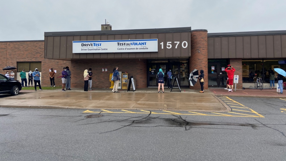 Drivers wait in line on a rainy Aug. 4, 2020 outside the DriveTest Centre on Walkley Road in Ottawa for a chance to take a G2 road test. (Dylan Dyson / CTV News Ottawa)