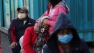 People line up to be tested for COVID-19 at the Unidad Educativa Quitumbe school that has been enabled by the as a triage unit and to help hospitals that are operating at the limit of their capacity during the new coronavirus pandemic, in Quito, Ecuador, Monday, Aug. 3, 2020. (AP Photo/Dolores Ochoa)