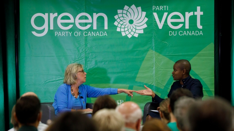 Green Party of Canada leader Elizabeth May, left, speaks with Toronto area candidate Annamie Paul during a fireside chat about the climate, in Toronto on September 3, 2019. THE CANADIAN PRESS/Cole Burston