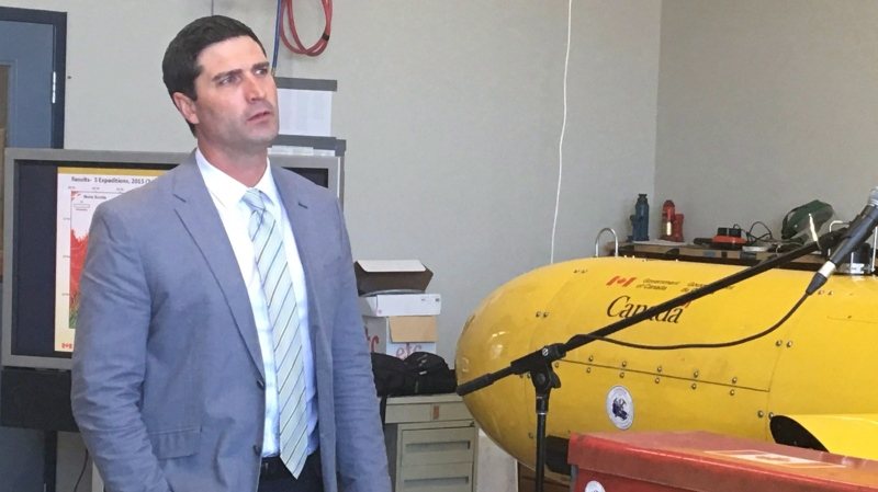 Nova Scotia Minister of Energy Geoff MacLellan watches video on the undersea exploration for oil during an announcement at the Bedford Institute of Oceanography in Halifax on Wednesday, June 20, 2018. Nova Scotia's government has sold Liscombe Lodge resort to a private operator, officially ending its role in the resort business. THE CANADIAN PRESS/Michael Tutton