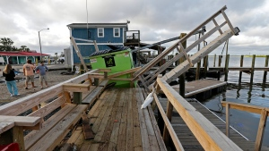 A waterfront dock shows damage following the effects of Hurricane Isaias in Southport, N.C., Tuesday, Aug. 4, 2020. (AP / Gerry Broome)