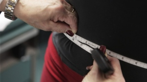 In this Jan. 20, 2010, file photo, a waist is measured during an obesity prevention study at Rush University Medical Center in Chicago. THE CANADIAN PRESS/AP-M. Spencer Green