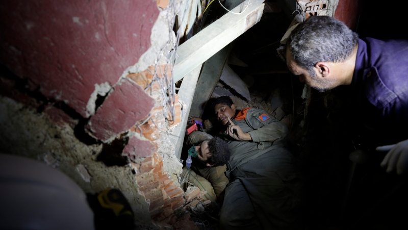 Lebanese soldiers search for survivors after a massive explosion in Beirut, Lebanon, Wednesday, Aug. 5, 2020. (AP Photo/Hassan Ammar)