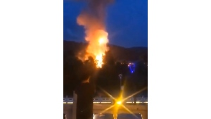 In this image taken from an Aug. 3, 2020, video provided by Wang Bo via AP Video, plumes of smoke and fire can be seen rising from Hyesan, a North Korean city, seen across the border from a park in the Chinese border town of Changbai in northeastern China's Jilin Province. (Wang Bo via AP Video)