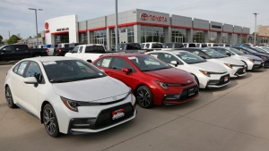 FILE - In this May 12, 2020 photo, Toyota's are shown on the lot of Mark Miller Toyota Dealership in Salt Lake City. (AP Photo/Rick Bowmer)