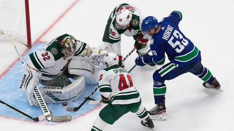 Minnesota Wild goaltender Alex Stalock (32) makes a save against Vancouver Canucks' Bo Horvat (53) during third period NHL Stanley Cup qualifying round action in Edmonton, Tuesday, Aug. 4, 2020. THE CANADIAN PRESS/Codie McLachlan