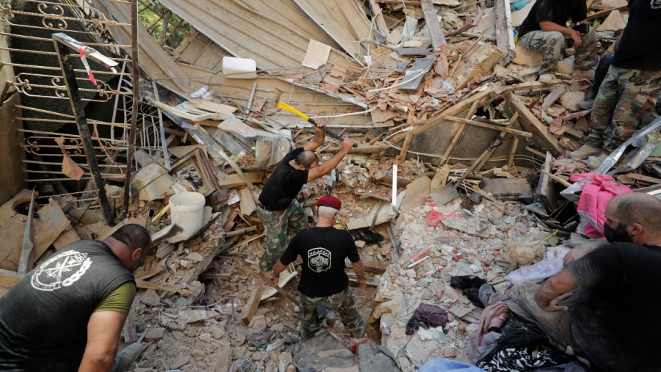 Lebanese soldiers search for survivors on Aug. 5, 2020, the day after a massive explosion in Beirut, Lebanon. (Hassan Ammar / AP)
