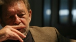 In this June 5, 2007 file photo, Pete Hamill responds during an interview at the Skylight Diner in New York. The longtime New York City newspaper columnist and author has died. His brother Denis Hamill said Pete died Wednesday, Aug. 5, 2020 in Brooklyn. (AP Photo/Bebeto Matthews, File)