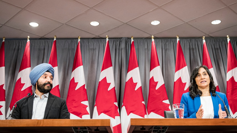 Navdeep Bains, Minister of Innovation, Science and Industry and Anita Anand, Minister of Public Services and Procurement make an announcement regarding vaccine procurement, in Toronto, on Wed., Aug., 5, 2020. THE CANADIAN PRESS/Christopher Katsarov