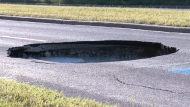 Water main break likely caused sinkhole
