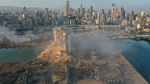 A drone picture shows the scene of an explosion at the seaport of Beirut, Lebanon, Wednesday, Aug. 5, 2020. (AP Photo/Hussein Malla)