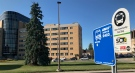 A combined intercommunity and London transit bus stop is seen in front of Building 'E' at the London Health Sciences Centre's Victoria Campus in London, Ont. on Wednesday, Aug. 5, 2020. (Sean Irvine / CTV News)