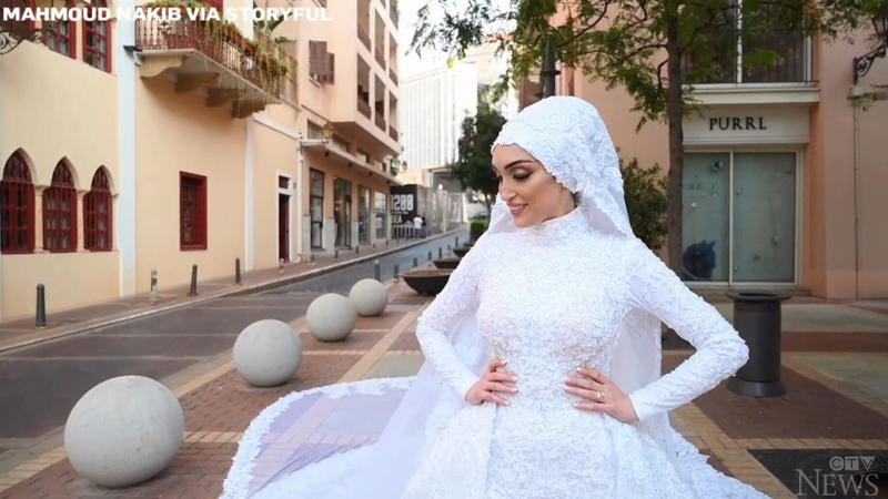 Israa Seblani was posing in her wedding gown in a nearly empty square approximately one kilometre from the city's port on Tuesday when the blast hit.