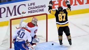 Pittsburgh Penguins centre Sidney Crosby (87) celebrates his goal as Montreal Canadiens goaltender Carey Price (31) and teammate Joel Armia (40) look on during first period NHL hockey action in Toronto, Monday, Aug. 3, 2020. THE CANADIAN PRESS/Nathan Dentte