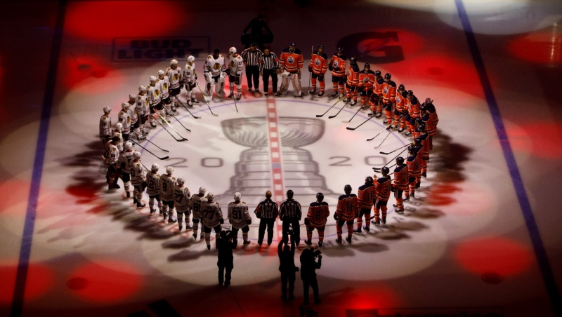 Edmonton Oilers and the Chicago Blackhawks circle for the national anthem before an NHL playoff game in Edmonton, Saturday, Aug. 1, 2020. THE CANADIAN PRESS/Jason Franson​