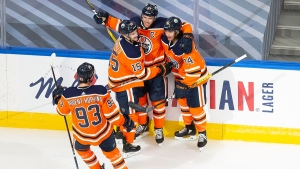 Edmonton Oilers' Ryan Nugent-Hopkins (93), Josh Archibald (15), Connor McDavid (97) and Ethan Bear (74) celebrate a goal during first period NHL Stanley Cup qualifying round action against the Chicago Blackhawks, in Edmonton, Monday, Aug. 3, 2020. THE CANADIAN PRESS/Codie McLachlan