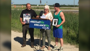 Susan Boyer, centre, mother of Ethan Boyer, speaks at an event announcing the naming of a new service road as Ethan Boyer Way on Wednesday. Ethan, 19, was killed in a collision in the area last year. (CTV News Photo Gary Robson)