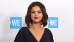 Selena Gomez arrives at WE Day California on April 19, 2018, in Inglewood, Calif. Gomez is taking the heat in the kitchen. (Photo by Richard Shotwell/Invision/AP, File)