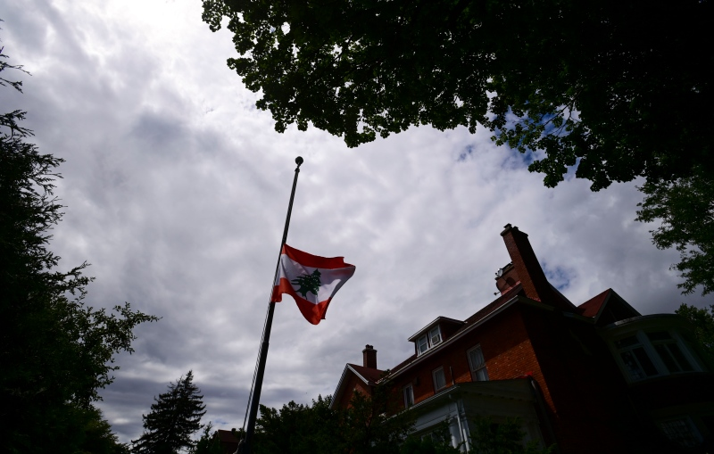 The Lebanese flag flies at half-staff at the Embassy of Lebanon in Ottawa on Wednesday, Aug. 5, 2020, following an explosion in Beirut yesterday that killed at least 100 people and wounded thousands. (Sean Kilpatrick/THE CANADIAN PRESS)