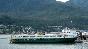 The Wilderness Adventurer is shown Wednesday, Aug. 5, 2020, following its return to Juneau, Alaska, after one of its 36 passengers tested positive for COVID-19. The first cruise of the stunted season was cut short, and all passengers were required to quarantine at a hotel while the 30 crew members were to quarantine on the ship. (AP Photo/Becky Bohrer)