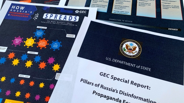 Pages from the U.S. State Department's Global Engagement Center report released on Aug. 5, 2020, are seen in this photo. (AP Photo/Jon Elswick)