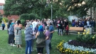 Dozens of people gather in an Ingersoll, Ont. park on Wednesday, Aug. 5, 2020 for a vigil to remember Ashten Fick. 