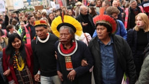 FILE - In this May 17, 2019 file photo, Brazil's rainforest activist Chief Raoni Metuktire, center front, takes part in a march for climate in Brussels. (AP Photo/Francisco Seco, File)