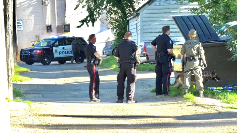 Edmonton police officers investigating after a man was shot with a shotgun. Aug. 5, 2020. (Sean Amato/CTV News Edmonton)