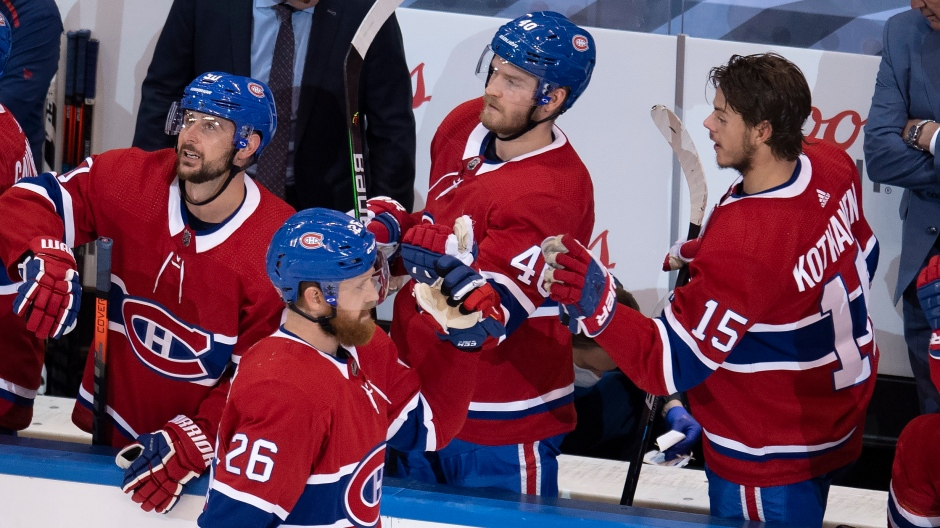 Montreal Canadiens defenceman Jeff Petry (26) is congratulated by teammates Tomas Tatar (90), Joel Armia (40) and Jesperi Kotkaniemi (15) after scoring against the Pittsburgh Penguins during third period NHL Eastern Conference Stanley Cup playoff action in Toronto on Wednesday, August 5, 2020. (THE CANADIAN PRESS/Frank Gunn)