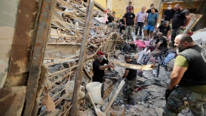 Lebanese soldiers search for survivors after a massive explosion in Beirut, Lebanon, Wednesday, Aug. 5, 2020. The explosion flattened much of a port and damaged buildings across Beirut, sending a giant mushroom cloud into the sky. In addition to those who died, more than 3,000 other people were injured, with bodies buried in the rubble, officials said.(AP / Hassan Ammar)